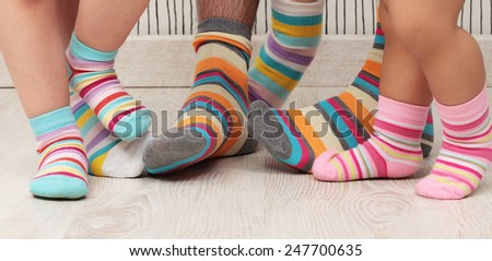 dad, mom and daughters with socks - stock photo