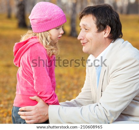 Dad pitying daughter. Sad child with father - stock photo