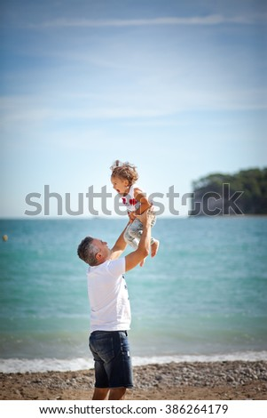 dad playing with his daughter