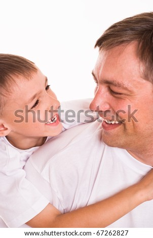 dad playing with his son on a white