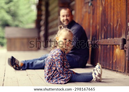 Dad walks with her daughter in the park - stock photo