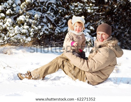Dad with daughter in winter park - stock photo