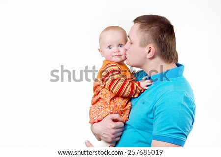 Dad with 6-month baby in his arms, photo shoot in the studio on a white background - stock photo