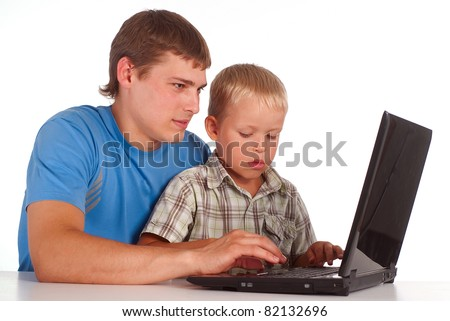 dad with son playing  with laptop
