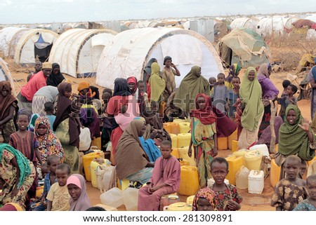 DADAAB, SOMALIA - AUGUST 06: Refugee camp, hundreds of thousands of difficult conditions, Somali immigrants are staying. African people waiting to get in the water. August 06, 2011 in Dadaab, Somalia. - stock photo