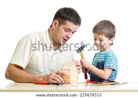 Daddy and child kid tinkering nesting box isolated