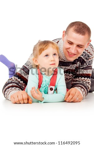daddy hugged the little girl, lying, posing isolated on white background - stock photo