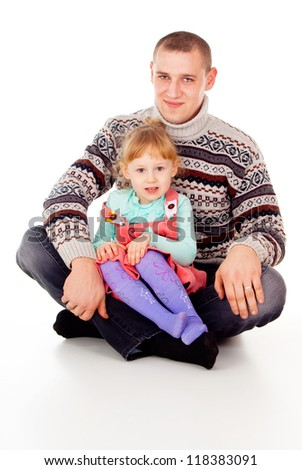 daddy hugged the little girl, sit isolated on white background - stock photo