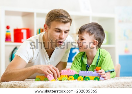 daddy with his kid son playing together - stock photo