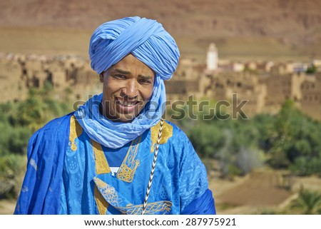DADES VALLEY, MOROCCO - MARCH 02: Portrait of unidentified Berber man with djellaba and turban on March 02, 2015 Morocco. Berber are an ethnic group in North Africa.                               - stock photo