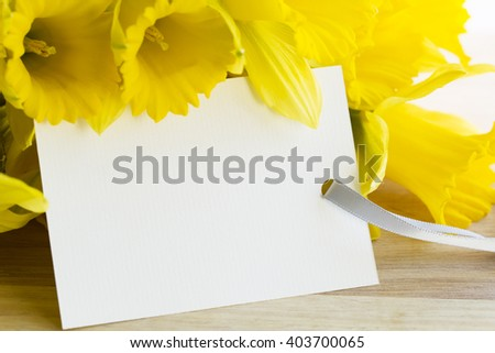 Daffodils and greeting card for spring, Easter, Mother's Day or just because. - stock photo