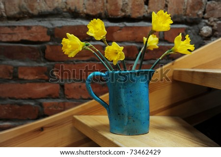 daffodils in vase - stock photo