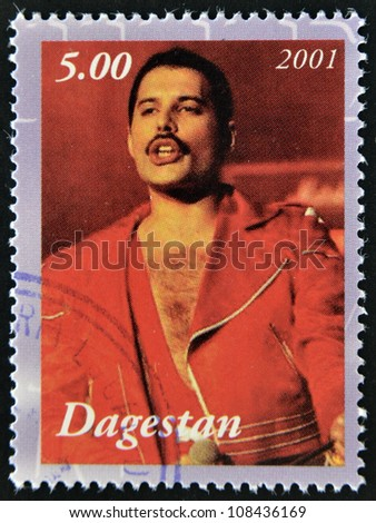 DAGESTAN - CIRCA 2001: A stamp printed in Republic of Dagestan shows Freddie Mercury leader the Queen, 1980s famous musical pop group, circa 2001 - stock photo