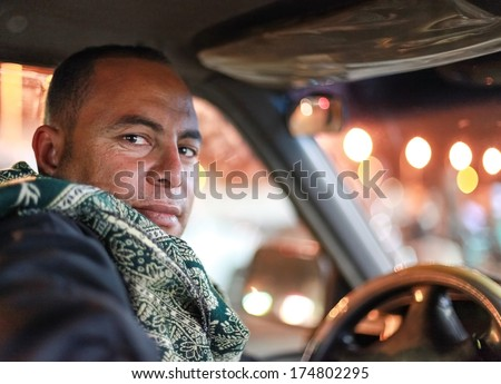 DAHAB, EGYPT - JANUARY 1, 2011: Portrait of the taxi driver. Taxi is favourite transport for western tourists visiting Egypt. - stock photo