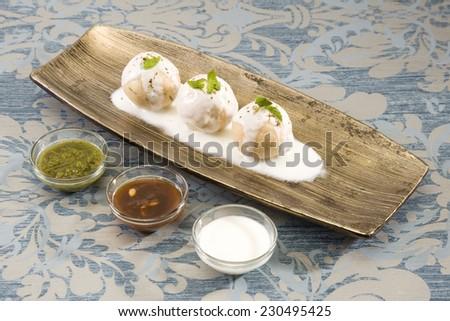 Dahi Bhalle Chaat or Stuffed Panipuri with Curd - stock photo