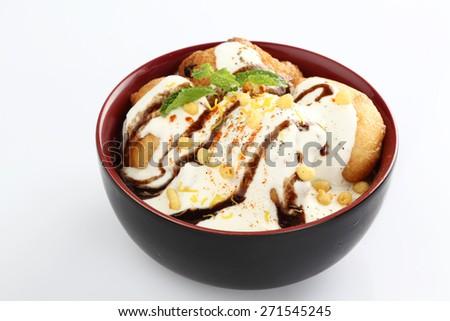 dahi wada or curd wada with chutney - stock photo