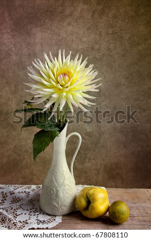 Dahlia Flowers in Vase with Quince and Lime fruit - stock photo