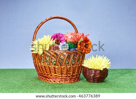 Dahlias, zinnia and other flowers in an Easter basket