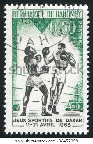 DAHOMEY - CIRCA 1963: stamp printed by Dahomey, shows boxer, circa 1963 - stock photo