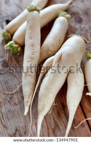 Daikon radish on the wood background