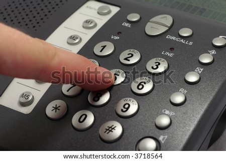 Dailing number on a black telephone