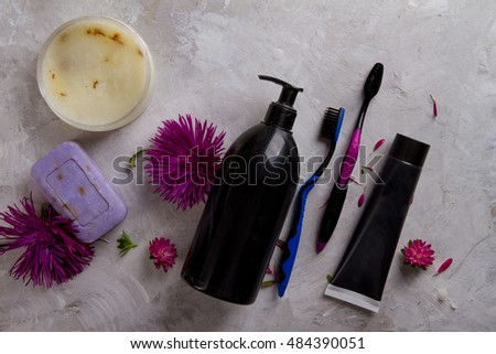 Daily body hygiene - toothpaste, toothbrush, soap, liquid shower gel and body scrub. Complex of cleaning products for your body, selective focus