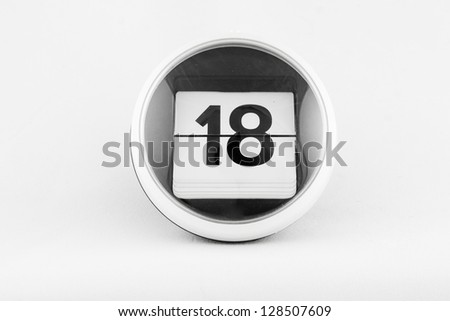 Daily calendar date change on a white background. day 18 - stock photo
