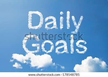 DAILY GOALS cloud word on sky - stock photo