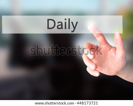 Daily - Hand pressing a button on blurred background concept . Business, technology, internet concept. Stock Photo