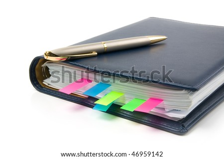 Daily planner with colored bookmarks. White background. - stock photo