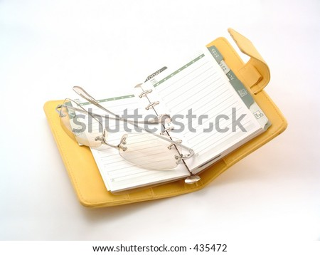 daily planner with glasses - stock photo