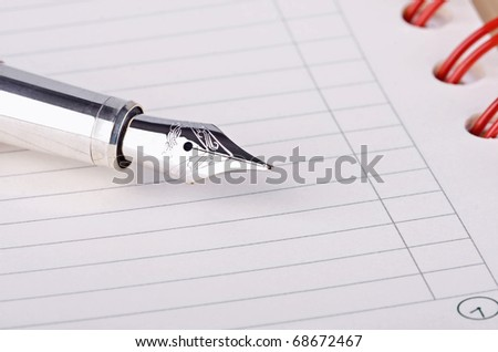 Daily planner with pen close up - stock photo