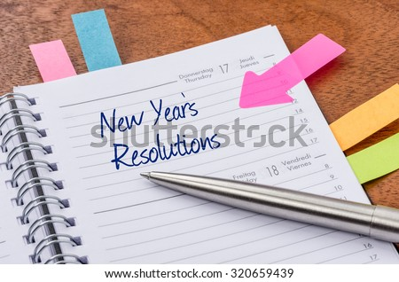 Daily planner with the entry New Years Resolutions - stock photo