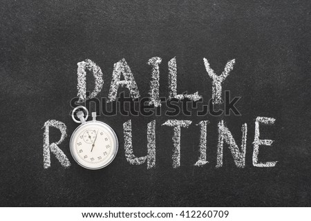 daily routine phrase handwritten on chalkboard with vintage precise stopwatch used instead of O