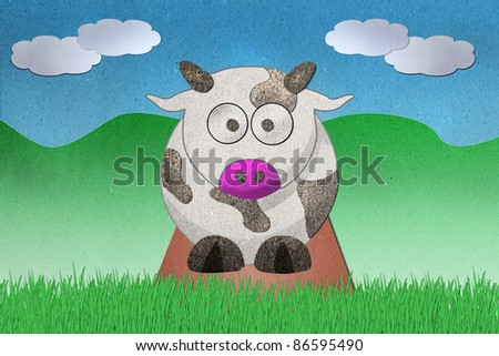 Dairy cows recycled paper craft on paper background - stock photo