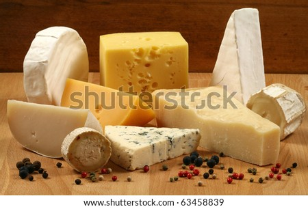Dairy delicacies. Variety of cheese: camembert, gouda, brie, parmesan, goat, sheep and other hard cheeses. - stock photo
