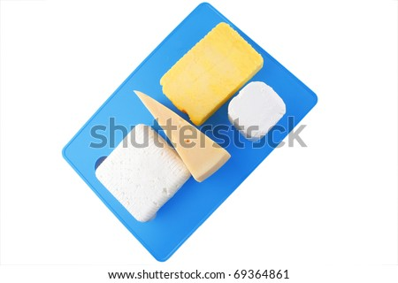 dairy food : soft delicious cheeses on blue plastic board isolated over white - stock photo