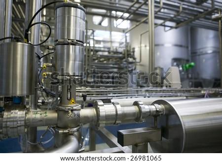 Dairy Plant. Conveyor with milk  bottles. - stock photo