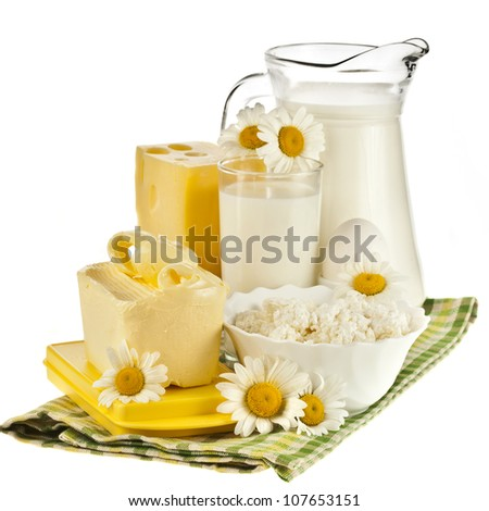 dairy produce on the tablecloth isolated on white background - stock photo