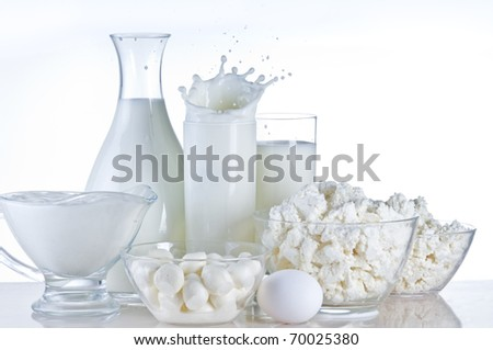 Dairy product and milk still-life over white background - stock photo