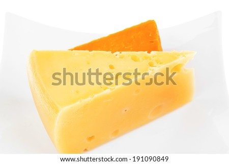 dairy product : two pieces of french gourmet cheeses (parmesan and cheddar) on plate isolated over white background - stock photo