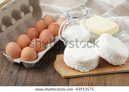 Dairy products and chicken eggs on a wooden table