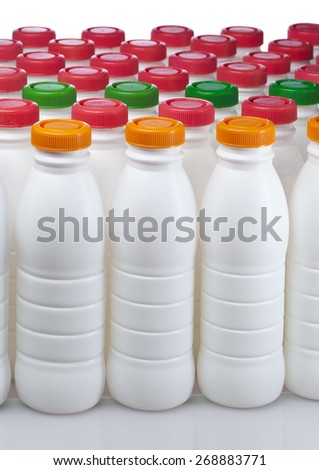 dairy products bottles with bright covers - stock photo