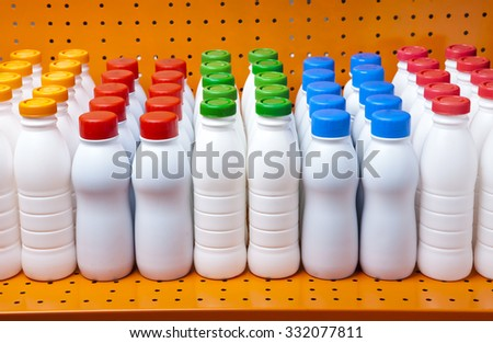 dairy products bottles with bright covers on a shelf in the shop