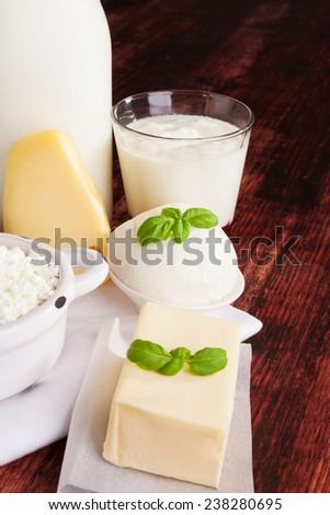 Dairy products milk, cheese, yogurt and curd on dark wooden background. Culinary healthy dairy products. - stock photo