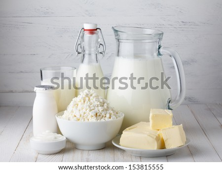 Dairy products, milk, cottage cheese, yogurt, sour cream and butter on wooden table - stock photo