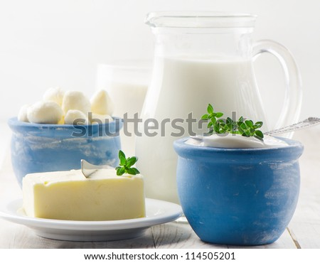 Dairy products on a wooden table - stock photo