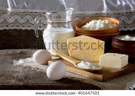 Dairy products on the table in a rustic style, with space for text.