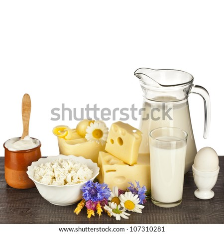 dairy products on the wooden table isolated on white background