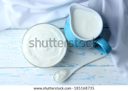 Dairy products on wooden table background - stock photo